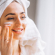 Woman applying pure haven skincare